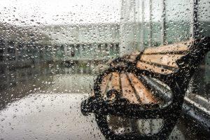 Raining On Wooden Bench